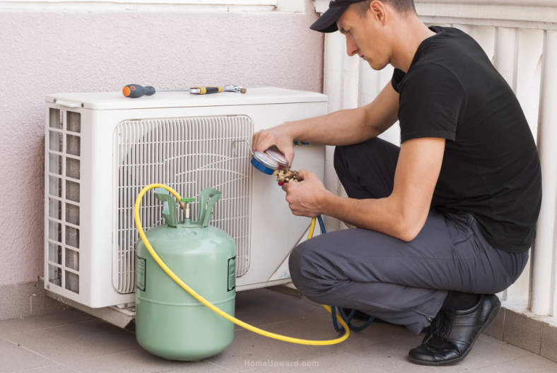 Example image of an HVAC technician adding freon to air conditioner