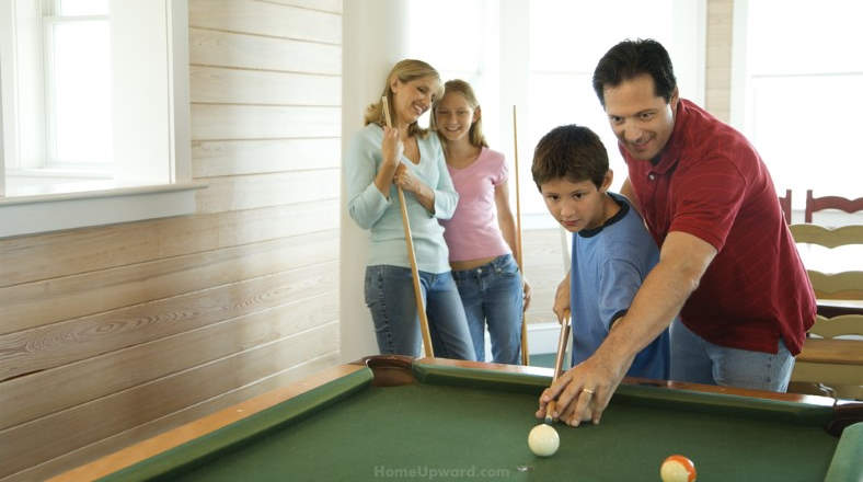how to clean billiard balls family playing billiards at home