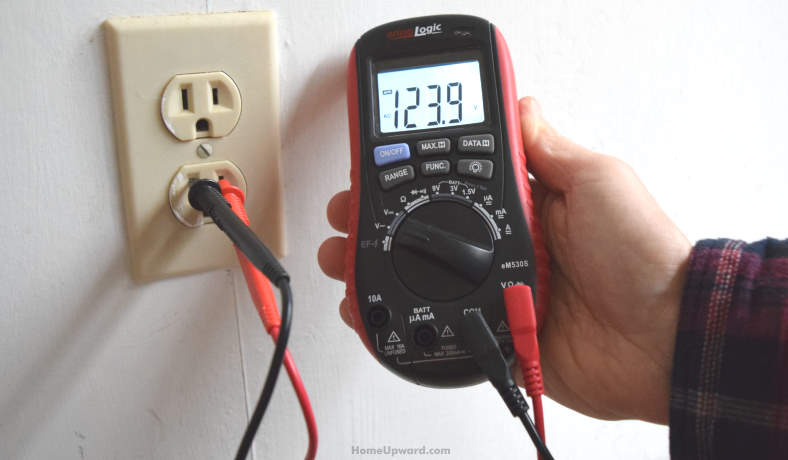 Example of checking an electrical outlet voltage with a digital test meter